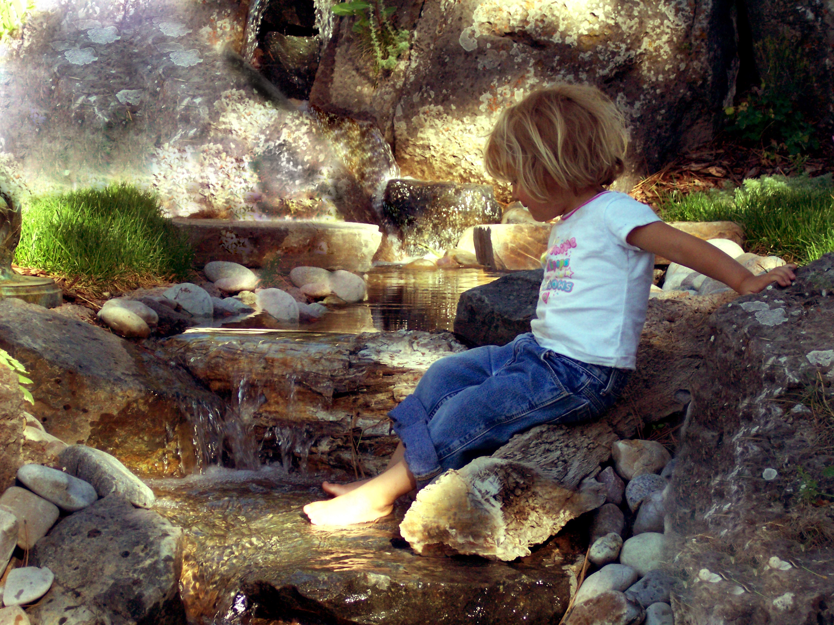 Girl playing in a Water Feature with Waterfall in Bozeman MT